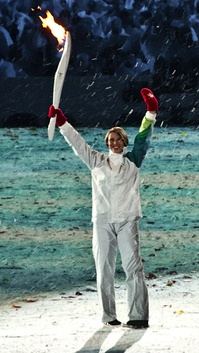 Le May Doan carrying the Olympic flame at the opening ceremonies of the 2010 Winter Olympics