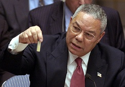 US Secretary of State Colin Powell holds a model vial of anthrax while giving a presentation to the Security Council in February 2003.