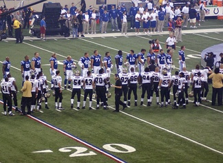 Colts and New Orleans Saints players line up on NFL opening day, September 6, 2007