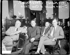 Informal portrait of (left to right) Cornelius P. Shea, John Miller, Fred Mader, and Tim Murphy sitting in a row in a courtroom in Chicago, Illinois, during a labor trial. Murphy was a politician, union organizer, and reputed gangster, and he was murdered in 1928.
