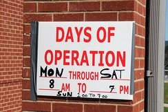 Hours of operation posted at a FEMA office following a disaster inform the public of when FEMA employees will be available to assist them.