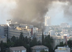 Smoke over Haifa, Israel, after a rocket launched by Hezbollah hit the city near Bnei-Zion hospital