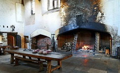 An original Tudor roasting hearth in the Great Kitchens at Hampton Court Palace, Richmond upon Thames, Greater London.