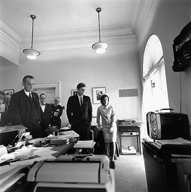 May 5: President Kennedy, Jackie Kennedy, and Vice President Johnson watch the launch of Freedom 7 from the office of his secretary, Evelyn Lincoln