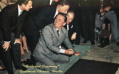Signing his name at Grauman's Chinese Theatre on November 1, 1962
