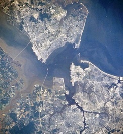 Newport News, Hampton, Portsmouth and Norfolk, Virginia, from space, July 1996. Newport News is seen in the upper-left quadrant.