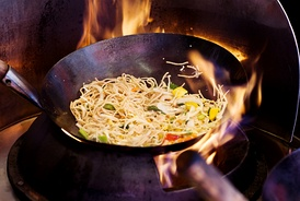 Bao stir frying involves high heat combined with continuous tossing. This keeps juices from flowing out of the ingredients and keeps the food crispy.