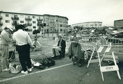 A journalist works on location at the Loma Prieta Earthquake in San Francisco's Marina District October 1989.