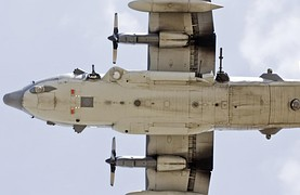 Underside of a USAF AC-130U; note the 25mm, 40mm and 105mm guns; and sensors.