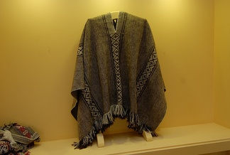 Traditional Mapuche poncho exhibited in Museo Artesanía Chilena.