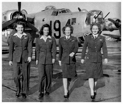 WASP pilots (left to right) Eloise Huffines Bailey, Millie Davidson Dalrymple, Elizabeth McKethan Magid and Clara Jo Marsh Stember, with a B-24 in the background