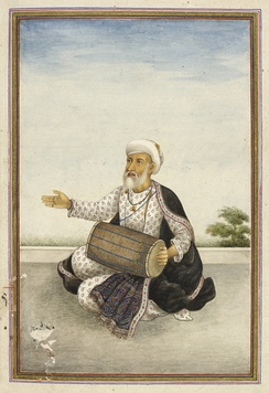A man depicted playing dhol