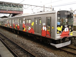 Robot characters from the Japanese science fiction television series  Ganbare!! Robocon  were used to decorate this train car.