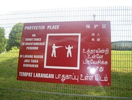 A multilingual sign in Singapore's four official languages: English, Chinese, Tamil, Malay.