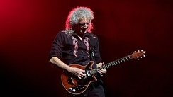 Brian May playing his custom-made Red Special at the O2 Arena in London in 2017. He has used this guitar almost exclusively since the band's advent in the early 1970s.