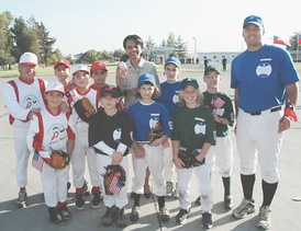 U.S. Secretary of State Condoleezza Rice poses with Little Leaguers from Chile in Santiago
