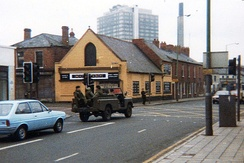 British soldiers driving through South Belfast in 1981