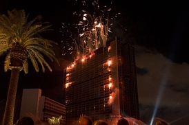 Fireworks light up the Stardust hotel in Las Vegas, Nevada as demolition charges inside begin to take down the building.
