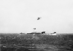 HMAS Australia (center) and TG17.3 under air attack on 7 May