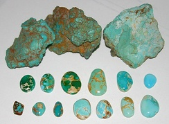 Untreated turquoise, Nevada, US. Rough nuggets from the McGinness Mine, Austin. Blue and green cabochons showing spiderweb, Bunker Hill Mine, Royston