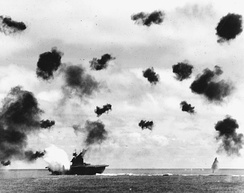 Aircraft carrier USS Yorktown hit by an aerial torpedo during the Battle of Midway.