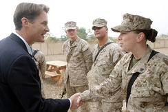 Bayh shakes the hand of a marine while visiting Iraq in January 2006