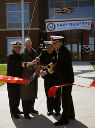 U.S. Navy admirals participate in the ribbon cutting ceremony for the opening of the new Navy Reserve Forces Command Headquarters at Naval Support Activity Norfolk.