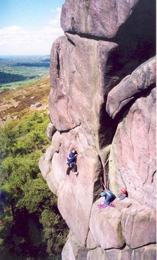 Rock climbers on Valkyrie at The Roaches in Staffordshire, England.