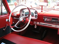 1958 Plymouth Savoy showing two-spoke steering wheel with horn ring, and aftermarket brodie knob, or steering wheel spinner