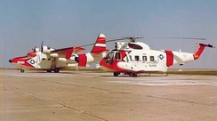 A Coast Guard Grumman HU-16E Albatross and a Sikorsky HH-52A Seaguard in March, 1964, probably at CG Air Station Mobile