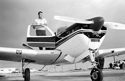 Astronaut Gordon Cooper, of Gemini V, poses on the wing of his personal Beechcraft Bonanza in 1963.