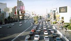 The Strip traffic during the day, looking north from the MGM Grand. The strip has a number of pedestrian footbridges.