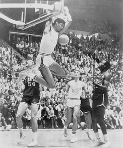 Lew Alcindor (later Kareem Abdul-Jabbar) makes a reverse two hand dunk