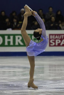 Mao Asada performs a Biellmann spin during her short program at the 2008-2009 Grand Prix Final