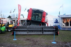 A Massey Ferguson combine fitted with the hillside leveling option