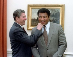 President Ronald Reagan clowning with Ali in the Oval Office in 1983
