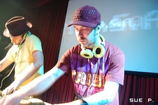 N.A.S.A. (DJ Zegon & Squeak E. Clean). The DJ on the left can be seen cuing up a part of a record by listening to the cue channel on one of his headphones.