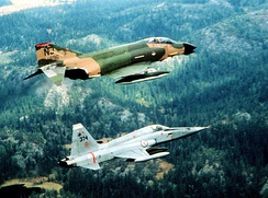 141st Squadron F-4D Phantom II with a Norwegian Air Force F-5 Freedom Fighter while deployed to NATO on 1 September 1982.[note 3]