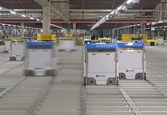 Robots move on the grid inside an Ocado warehouse
