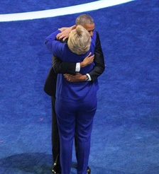 President Obama hugging Hillary Clinton