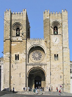Lisbon Cathedral, Portugal, 1147, has a similar form to the Old Cathedral of Coimbra above with the addition of two sturdy bell towers in the Norman manner and a wheel window.