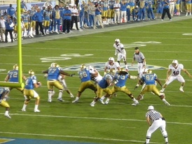 Stanford Cardinal playing the UCLA Bruins in the Rose Bowl Stadium