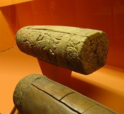 "Two Aztec slit drums (teponaztli). The characteristic ""H"" slits can be seen on the top of the drum in the foreground."