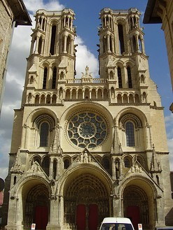 The facade of Laon Cathedral, 1225, a Gothic cathedral, maintains rounded arches and arcading in the Romanesque manner.