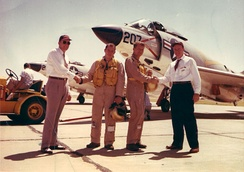 Schirra (2nd from right) and McDonnell Aircraft Design Chief, Dave Lewis at F3H Demon delivery (c. 1958)
