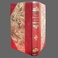 Hardbound book with half leather binding (spine and corners) and marbled boards.