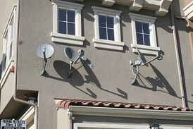 DBS satellite dishes installed on an apartment complex.