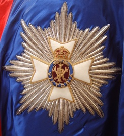 A detailed view of a stumpwork and goldwork embroidered star of a Knight or Dame Grand Cross of the Royal Victorian Order