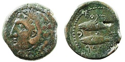 A Punic bronze coin from Gadir, modern Cádiz (Spain); the obverse shows a male head depicting Melkart (called Hercules by the Greeks and Heracles by the Romans); on the reverse are two tuna fish with several Phoenician letters.