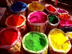 Colours for Holi on sale at a market in Mysore